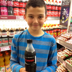 He was so excited to see a coke bottle with his brother's name on it.