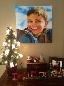 Connor's ashes surrounded by his own Christmas tree covered by his beloved R2D2.